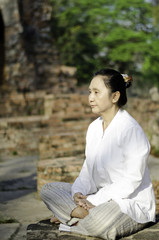 Asian woman meditating yoga