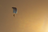 parachute diver at sunset poster
