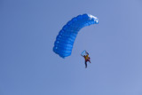 parachute flyier on clear blue sky poster
