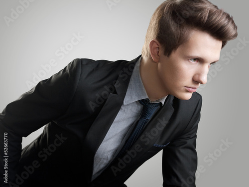 Short Hair Style.  Portrait of young man with  brown hair