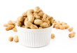 shelled great peanuts in a bowl on white background, closeup