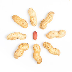 A pile of shelled big peanuts closeup on white background