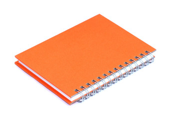 Orange notebook with shadow isolated on white background
