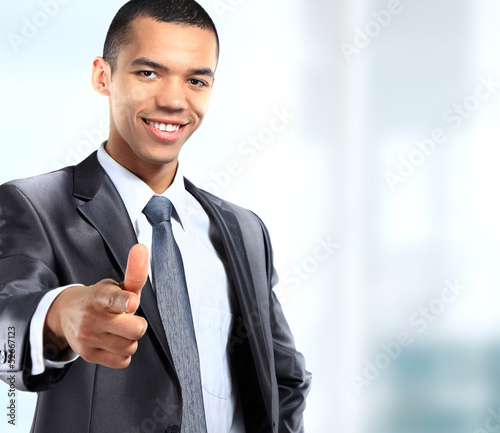 Young african business man giving thumb up, isolated on white