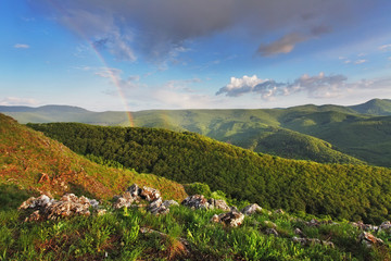 Rainbow in green mountain