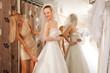 Women Trying On A Wedding Dress