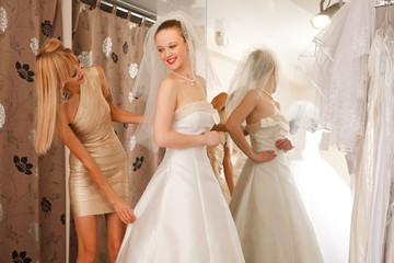 Women Trying On A Wedding Dress