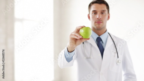 doctor with green apple in hands