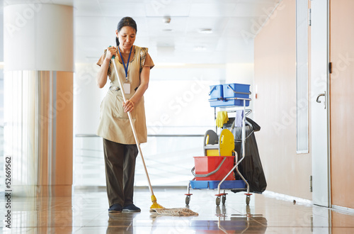 Leinwandbild Motiv Woman cleaning building hall