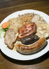typical food Slovenia black pudding fried sausage dried pork cho