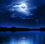 Fototapety Fantasy Moon and Clouds over water
