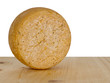 Round cheese on wooden board with white background