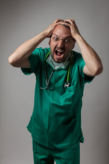 Portrait of a young physician shouting
