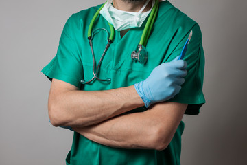 Physician holding a surgical knife