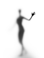 A silhouette of a young woman