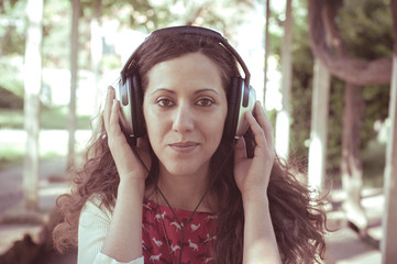 vintage hipster eastern woman with headphones