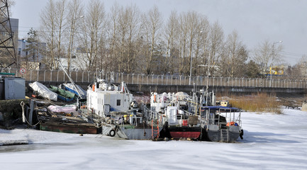 Old ships moored to port in the winter time