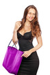Cute female with shopping bag looking to side