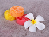 colorful soap for spa with frangipani flower