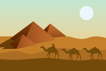 Bedouin camel caravan and pyramid silhouette