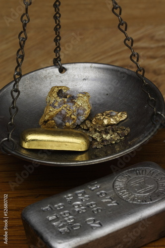 Gold Nuggets & Gold Bar on Balance Scale - Silver Ingot Beside