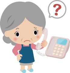 電話口で不審がる高齢の女性