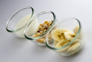 Healthy breakfast with milk, toasted muesli and banana slices