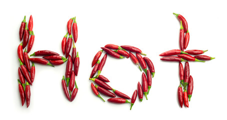 Ripe red chili peppers shaped in the word Hot