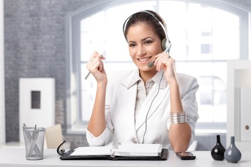 Smiling dispatcher with headset