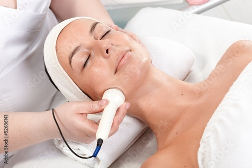 Facial treatment in beauty saloon