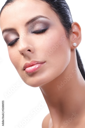 Closeup beauty portrait of attractive female model