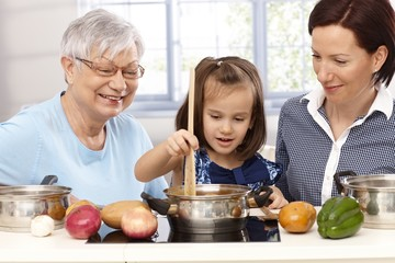 Three generations playing cooking