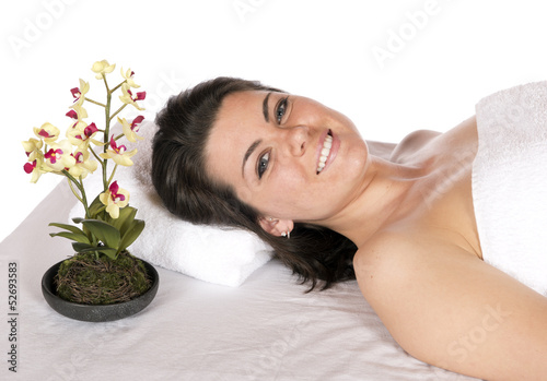 Day spa woman on massage table aroma