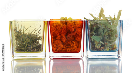 Dried herbs in glass containers isolated on white