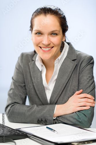 Confident smiling businesswoman looking at camera