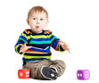 baby is playing with  toys over white background. Funny little k