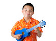 Boy in Orange Hawaiian T-Shirt Playing Ukulele