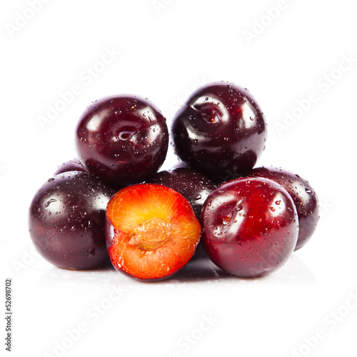 Red plum fruit isolated on white background.  Fresh ripe washed