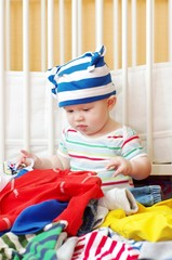 baby chooses clothes for walk