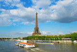 Eiffel tower with touristic boat on Seine