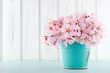 Cherry blossom flower bouquet on wooden background