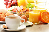 Fototapety Breakfast with coffee, orange juice, croissant, egg, vegetables