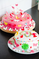 Delicious colorful decorated white and pink Marzipan cakes