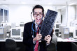 Crazy businessman hold keyboard at office