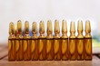 Row of brown vials filled