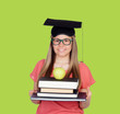 University with graduation cap and many books
