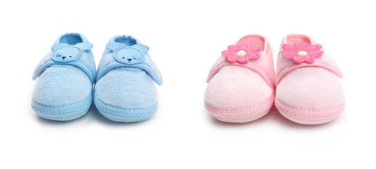 Two pairs of baby boy and girl shoes
