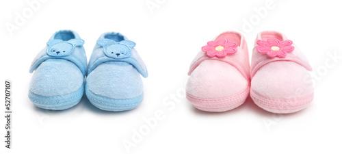 Leinwandbild Motiv Two pairs of baby boy and girl shoes