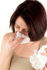 woman sneezing