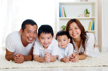 beautiful asian family lying on the floor